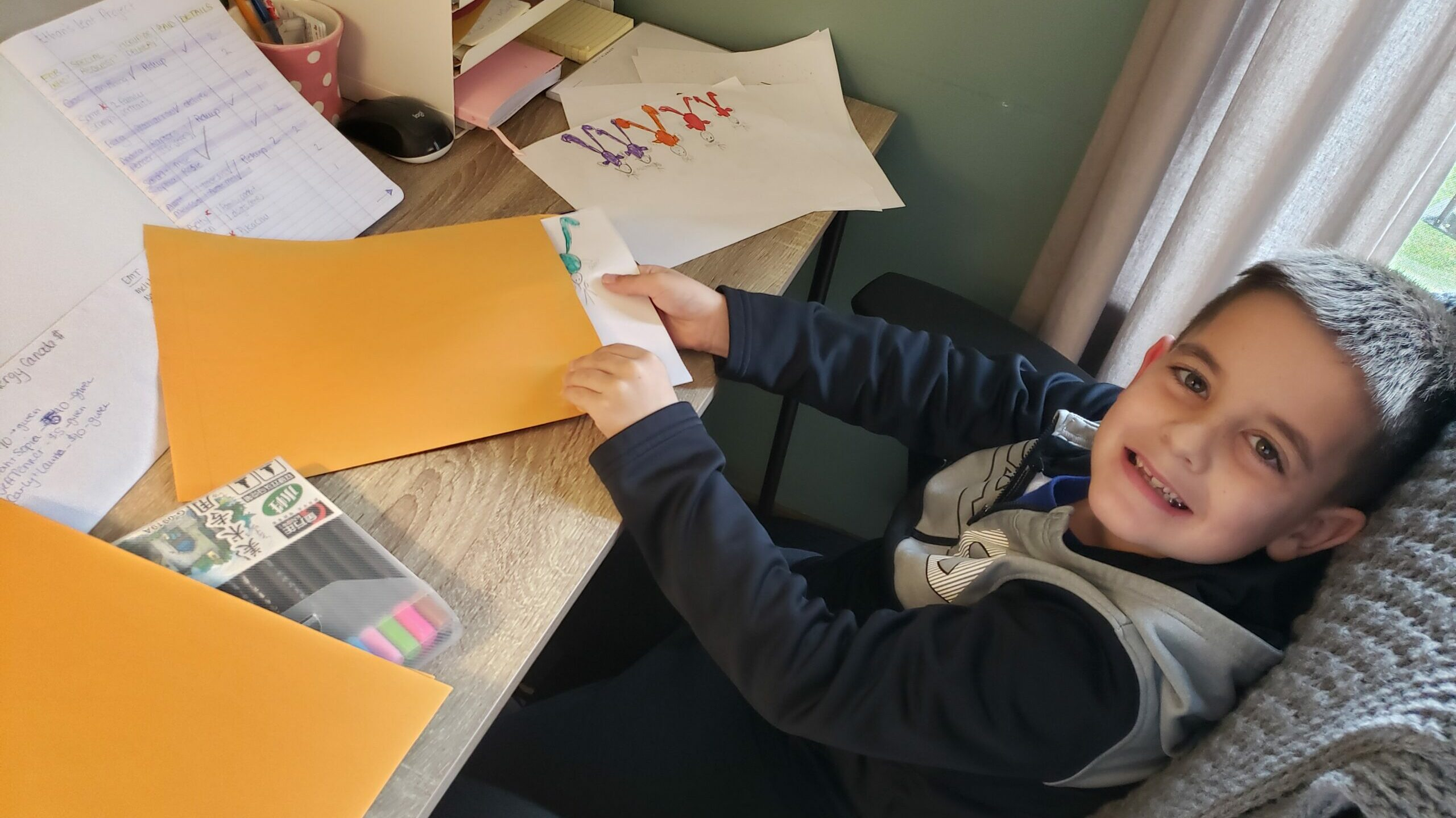 Ethan packaging his artwork, age 7