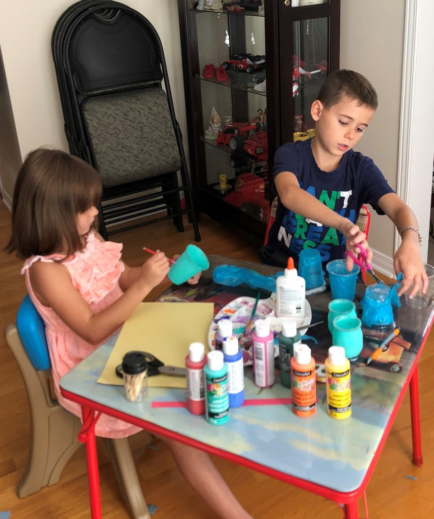 Christian and Adriana Di Criscio from Montreal create teal lantern crafts for Halloween.