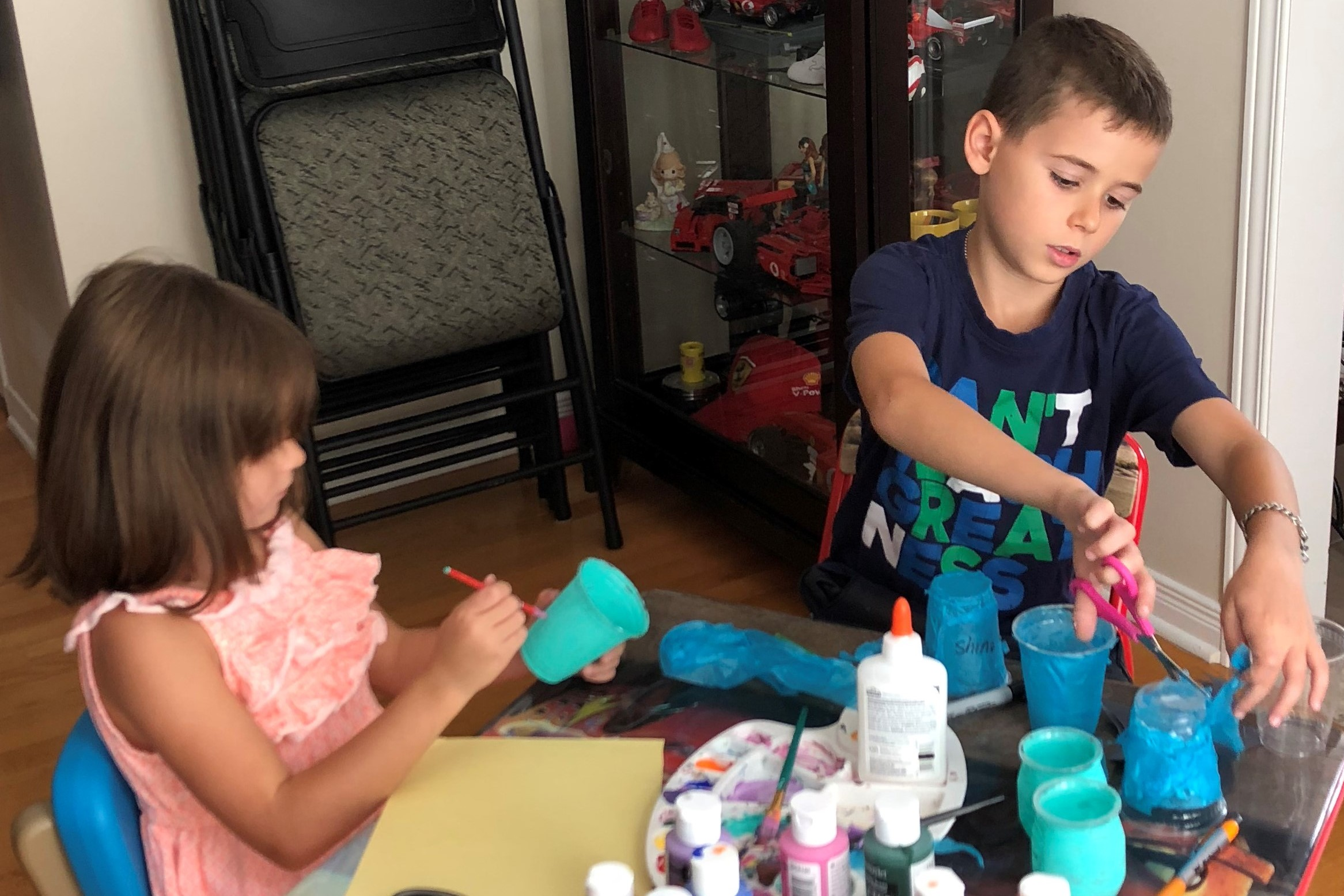 Adriana and Christian D. painting and making teal light crafts