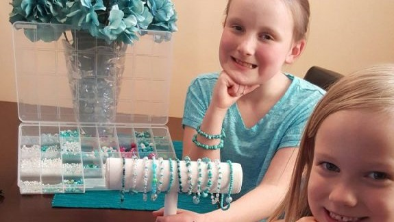 Danica and Delaney with their bracelets