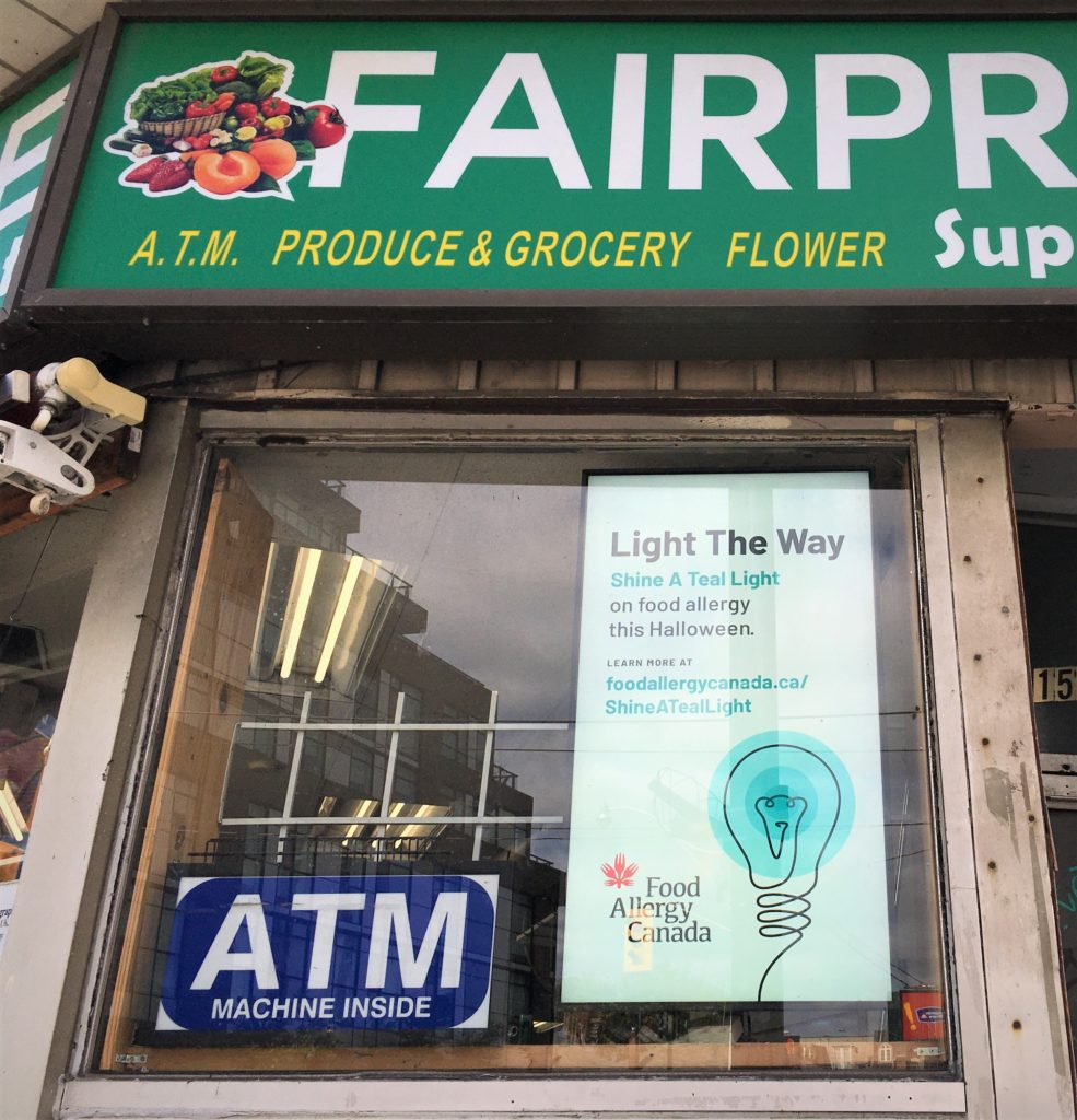 #ShineATealLight ad displayed on screen