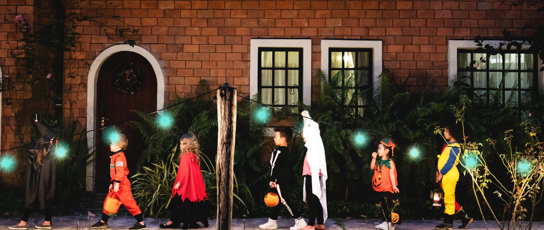 Children trick-or-treating while keeping social distance
