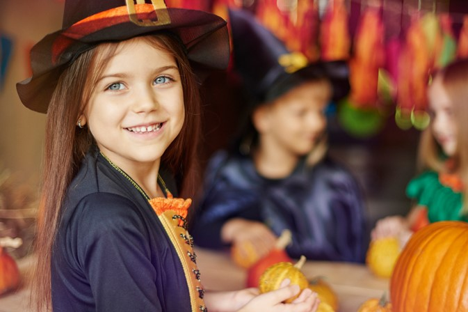 Girl dressed up as a witch on Halloween