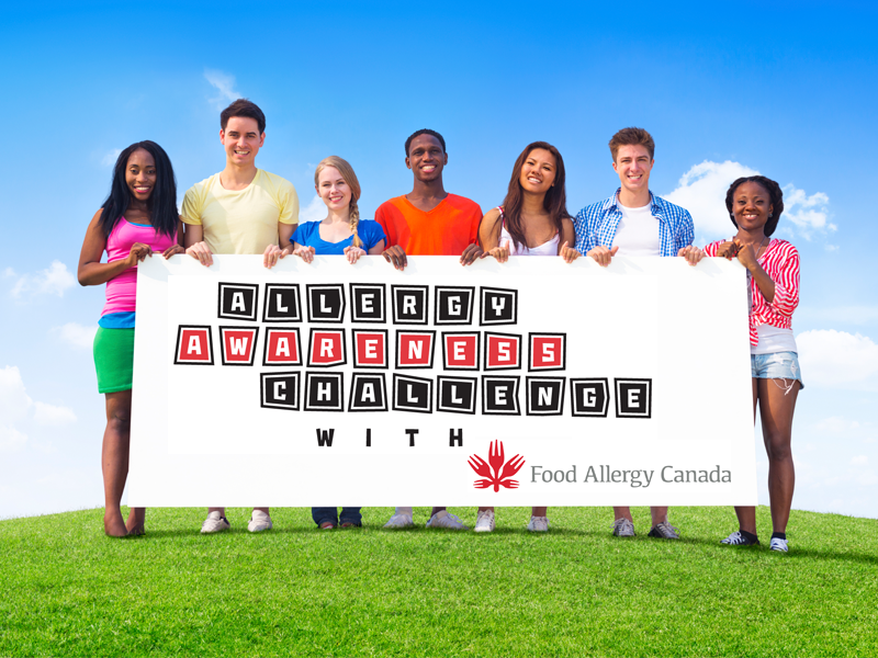 Youth holding Allergy Awareness Challenge logo