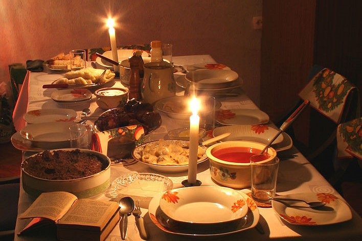 Candle-lit dinner table with food