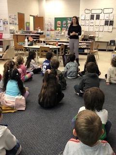 Aliya presenting to students at her elementary school