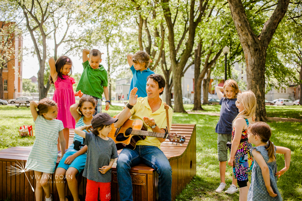 Kyle Dine, musician, singing with children