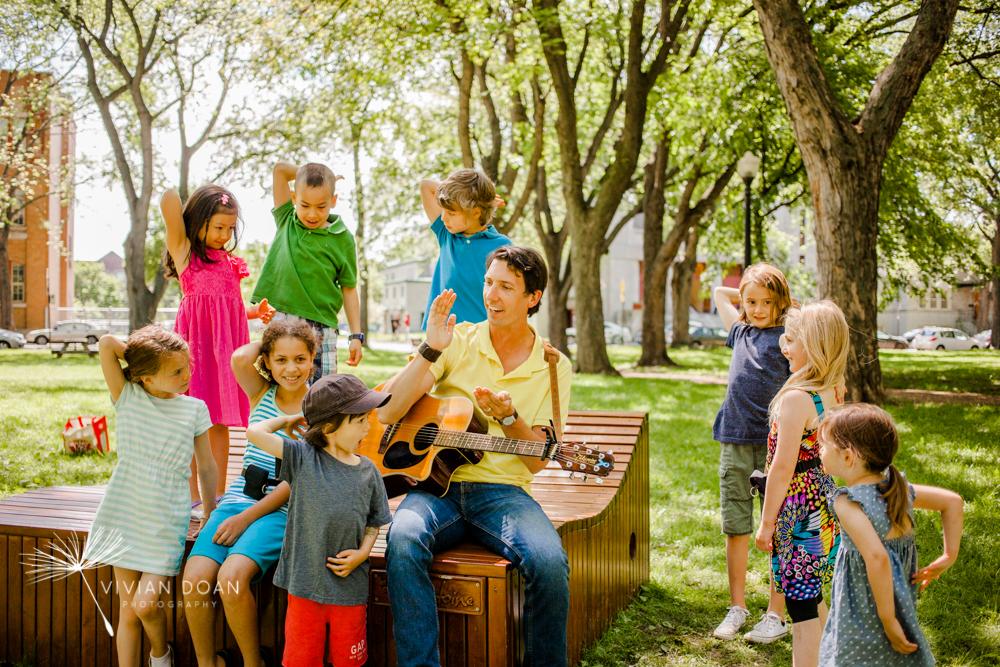 Kyle Dine, musician, singing with children