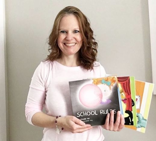 Michelle holding her books