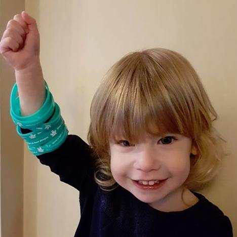 Shine a light bracelets on child's arm