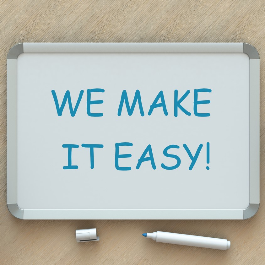 WE MAKE IT EASY!, message on whiteboard, smart phone and coffee on table