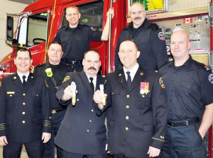 Firefighters Kevin Strong and Dave Pickard (back row) and (front from left to right) deputy chief Michael Rozario, Rick Walker, Doug Bolton, Reno Levesque and Scott Shepherd unveiled the addition of EpiPens to the Georgina Fire Department's arsenal of potentially life-saving equipment last week.