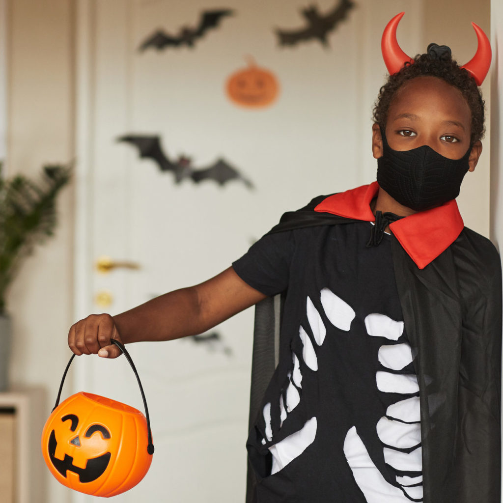 Boy Ready To Trick Or Treat Wearing Mask