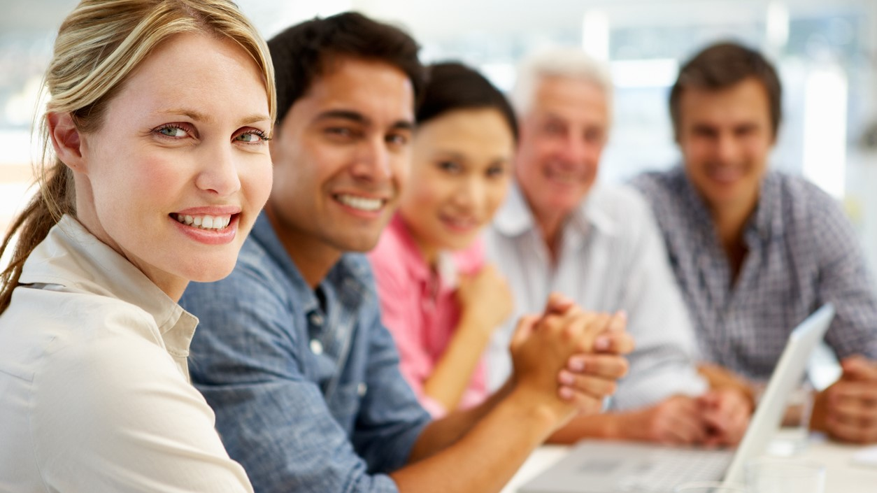 Mixed group in business meeting smiling