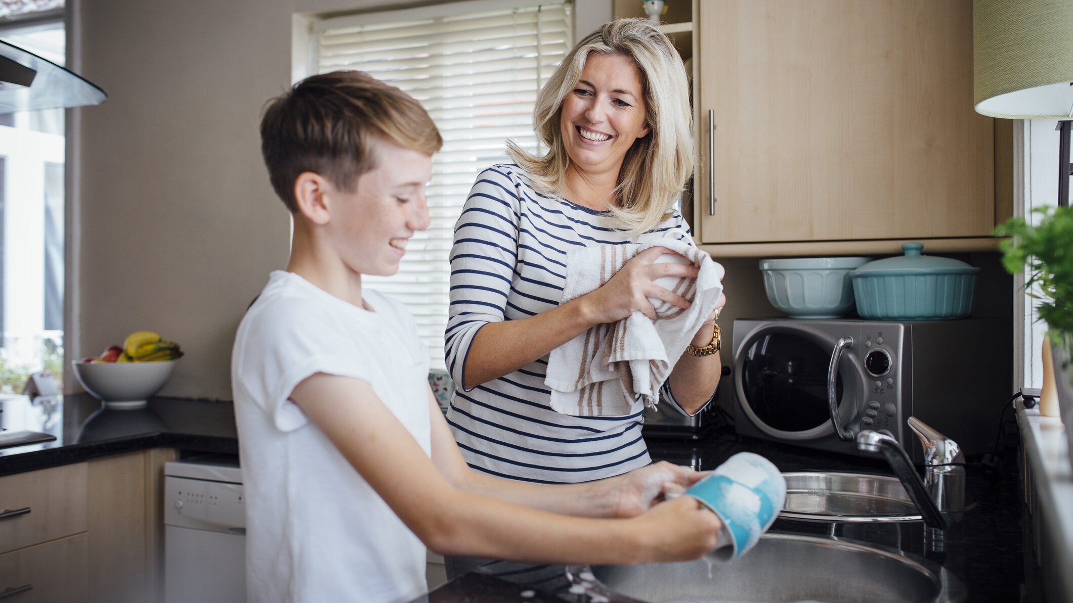 Mother and Son Doing the Dishes