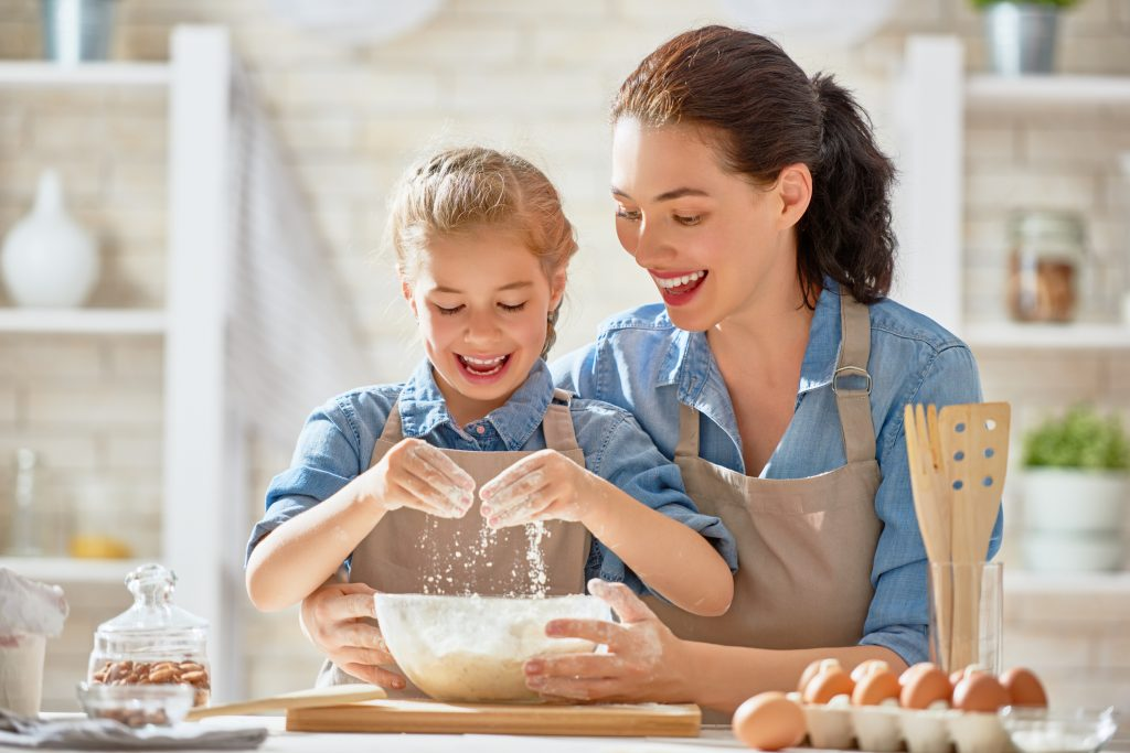 Mother and child baking together