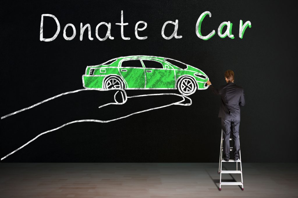 Donate a car written on Blackboard With Chalk
