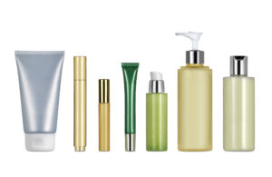Different cosmetics and creams containers against white background. Clipping path