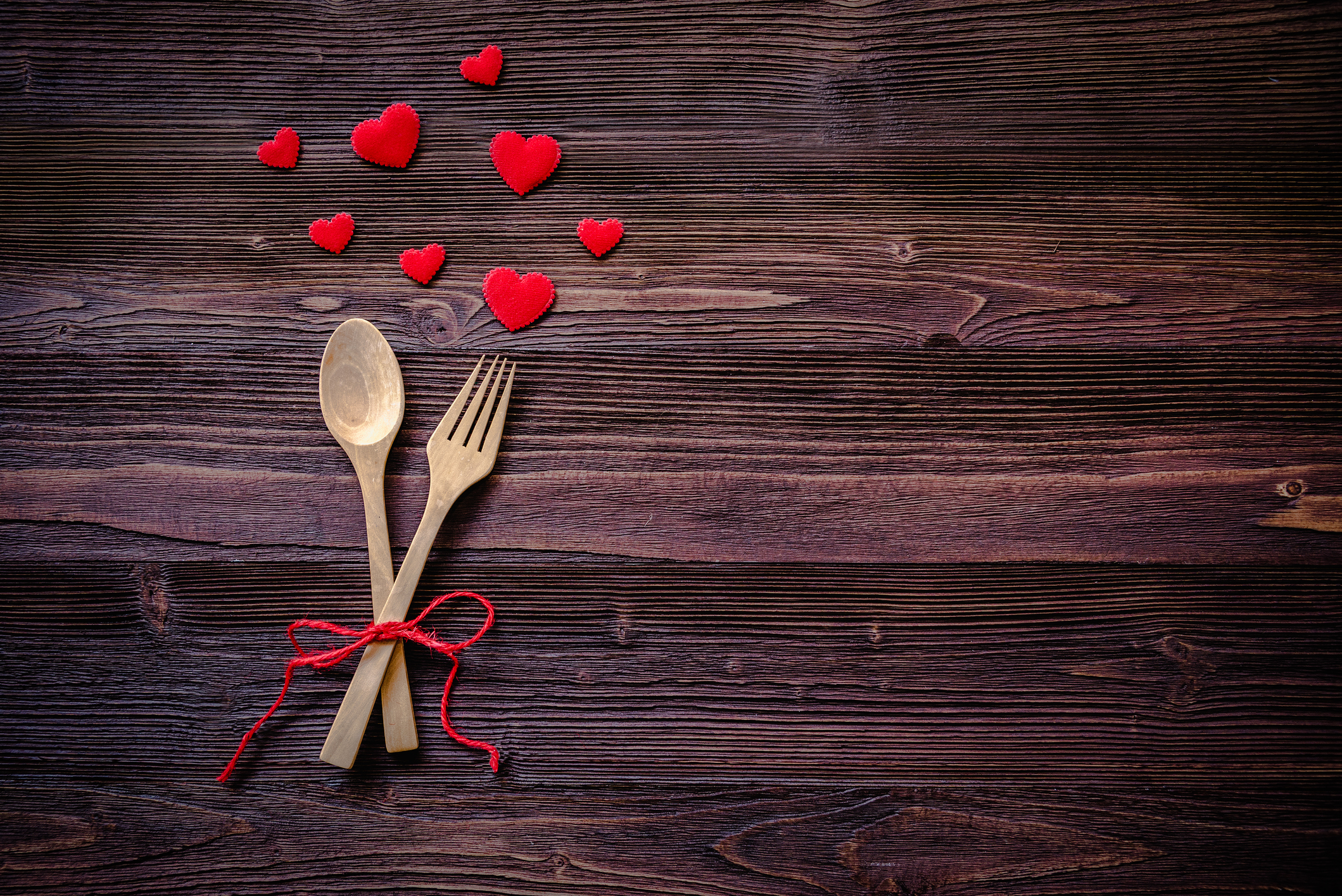 Dinner with table setting in rustic wood style with cutlery, red heart. Valentine day.