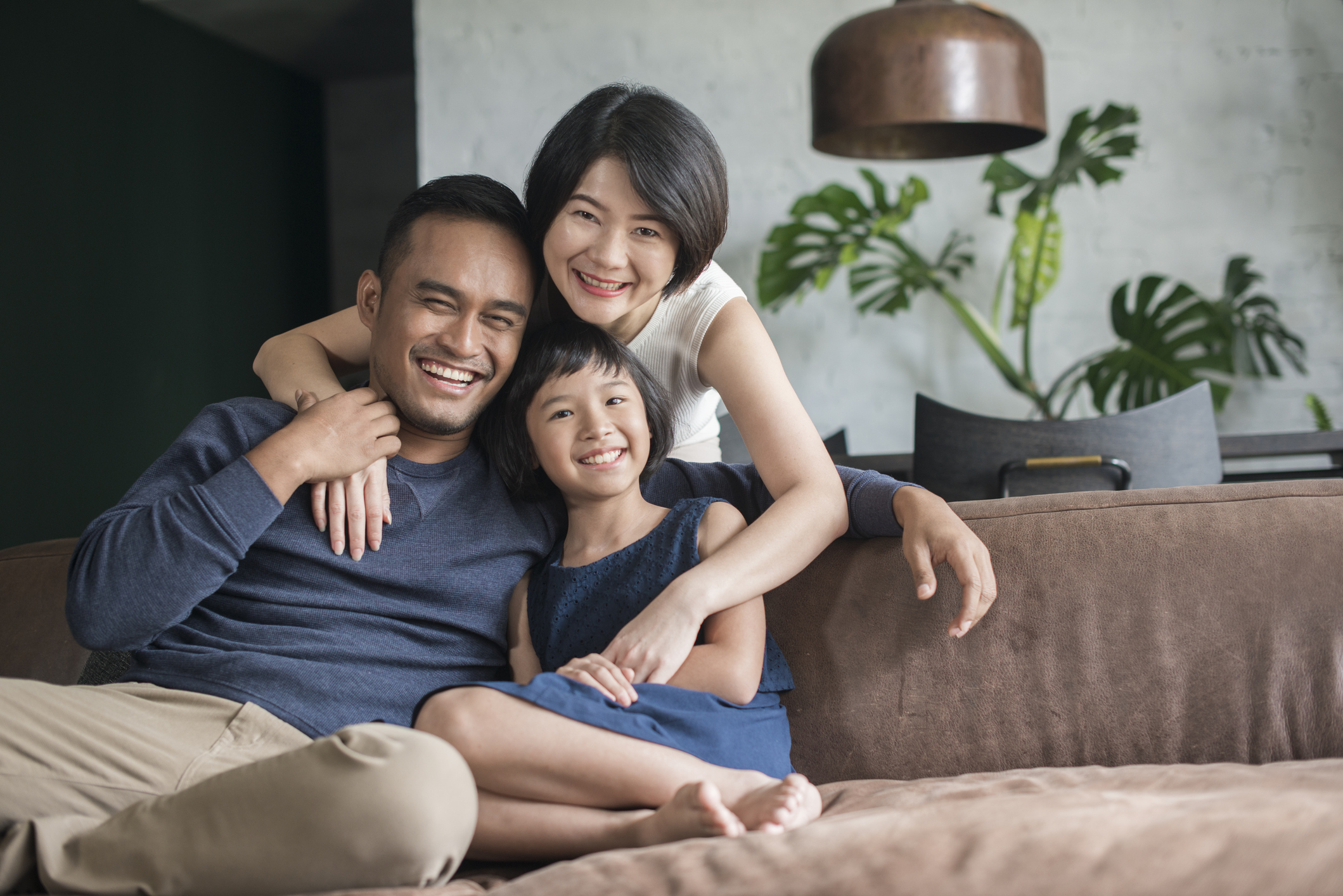 Young Asian family at home.