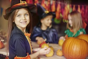 Busy children preparing Halloween decorations