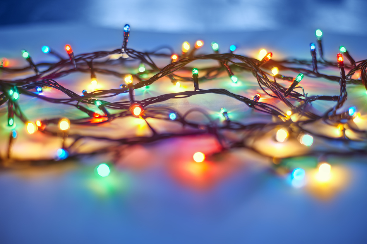 Christmas lights on dark blue background. Decorative garland
