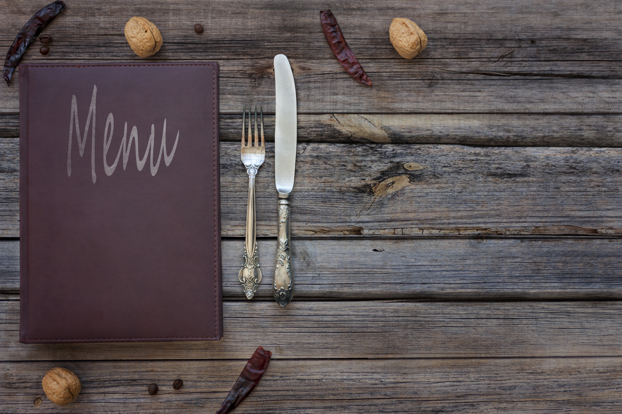 View of a vintage restaurant menu on a rustic wood background