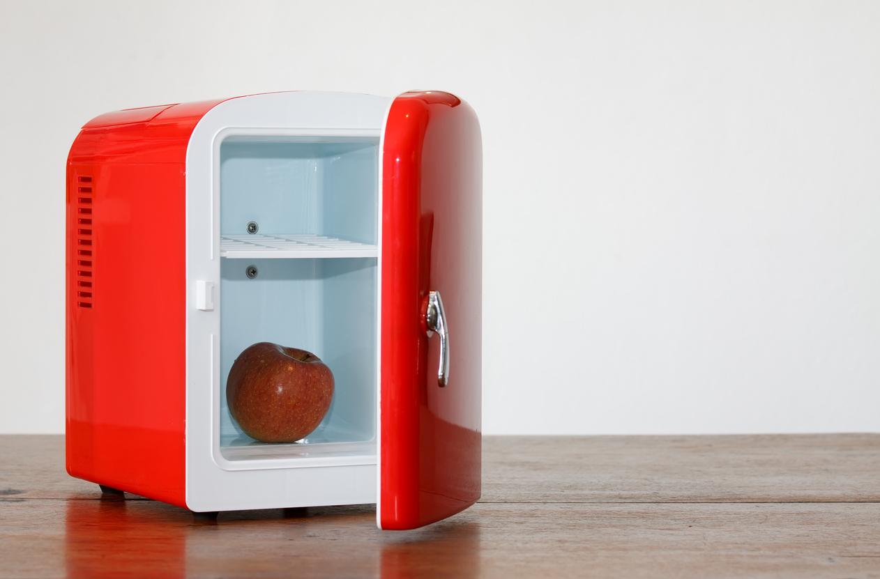 Shiny bright red miniature fridge