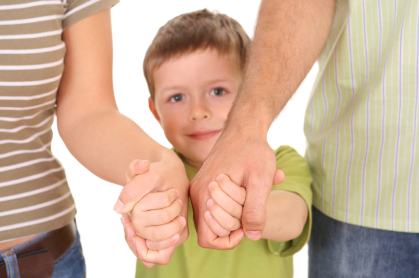 5-6 years old boy with his parents isolated on white