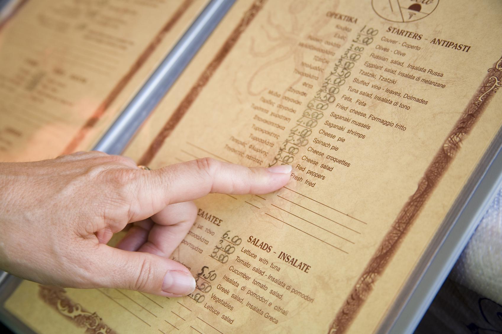 finger on a menu