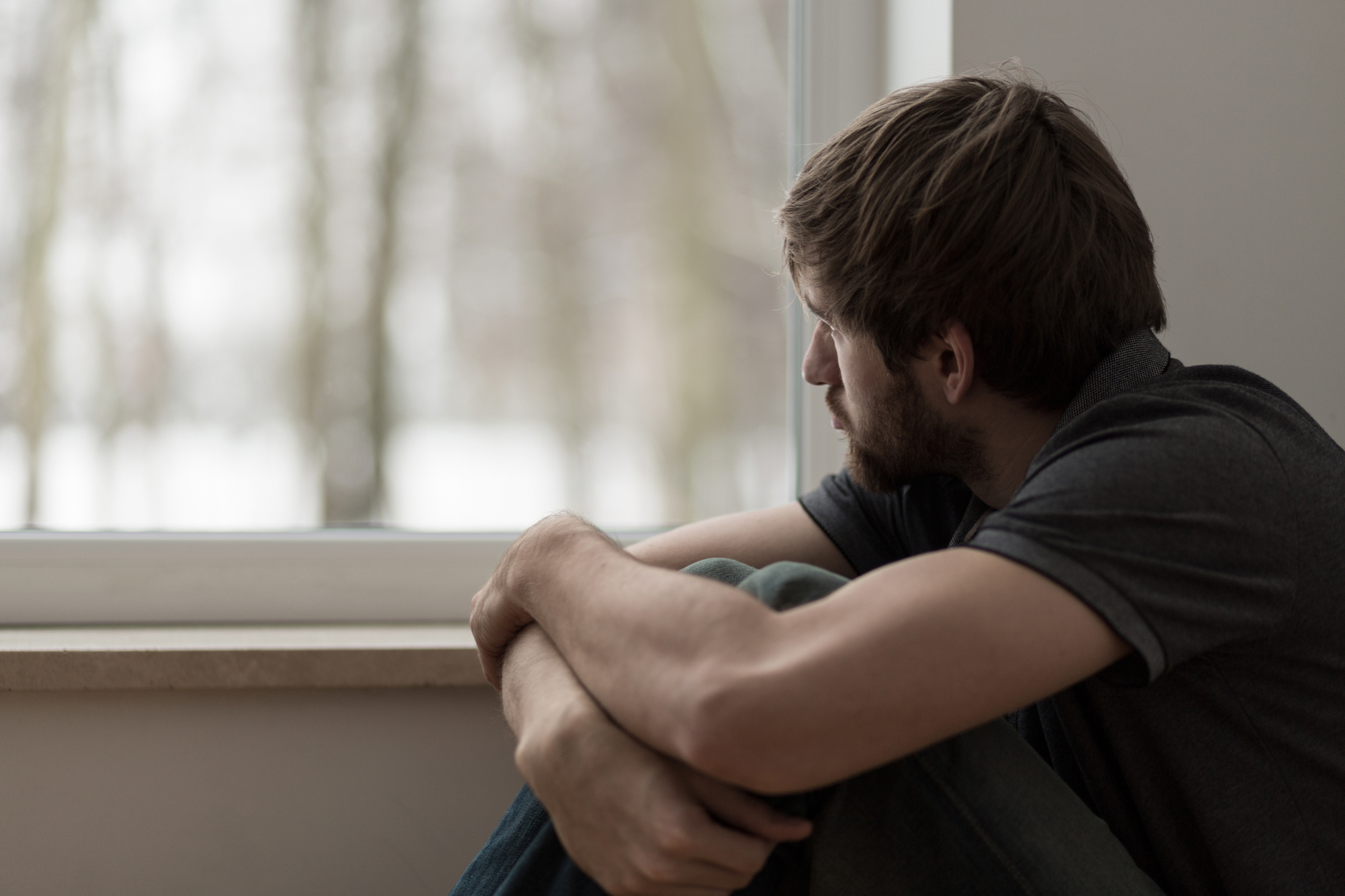 Portrait of young man suffering for depression