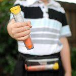 Boy holding EpiPen