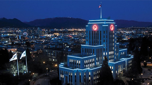 Vancouver City Hall lit up teal